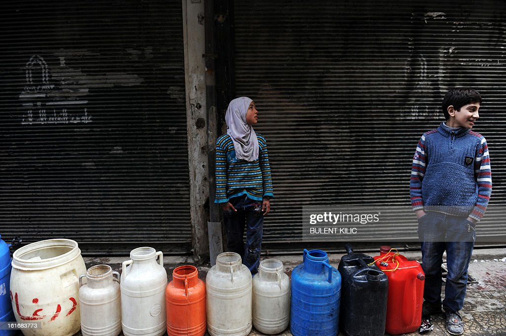Syrian children wait in line for water in the northern city of Aleppo on February 14, 2013. Syrian Foreign Minister Walid al-Muallem and opposition National Coalition chief Ahmed Moaz al-Khatib will make separate visits to Moscow for talks in the coming weeks, a top Russian diplomat said.