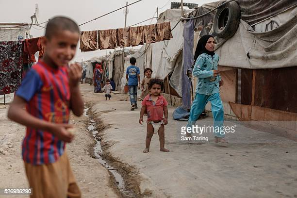 Syrian children walk through a refugee camp near Zahle in Lebanon on September 9 2015 The camp has been visited by Samantha Cameron and by Angelina...