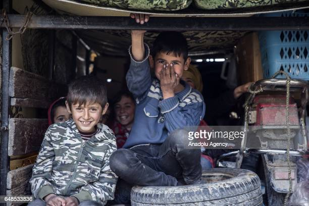 Syrian children who have returned to their home after the Al Bab town center has been entirely freed from Daesh terrorists as part of the Operation...