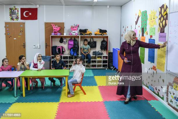 Syrian children who lost their parents in the fighting attend a class for orphans at the Boynuyogun refugee camp on September 16, 2019 in Hatay,...