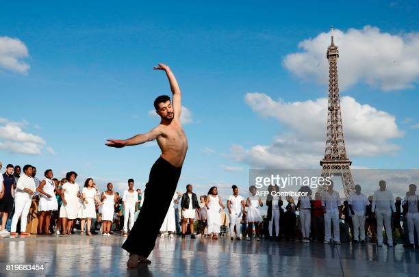 Syrian choreographer Ahmad Joudeh performs on the Human Rights Square in Trocadero near the Eiffel Tower in Paris on July 20 2017 GUILLOT