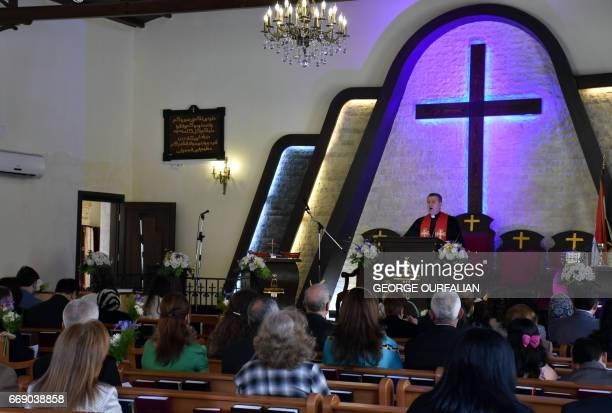 Syrian Christians attend a mass marking Easter Sunday at an Evangelical church in the northern Syrian city of Aleppo on April 16 2017 / AFP PHOTO /...