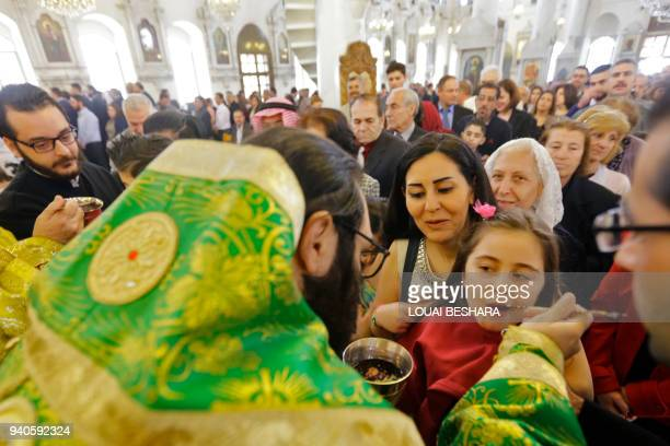 Syrian christians attend a mass to celebrate Palm Sunday at the Mariamite Cathedral of Damascus one of the oldest Greek Orthodox churches in the...