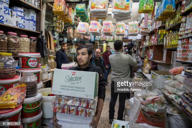 Syrian civilian carries his goods out of his shop after PKK/PYD terror group fired seven missiles from Afrin region where Turkish Armed Forces...