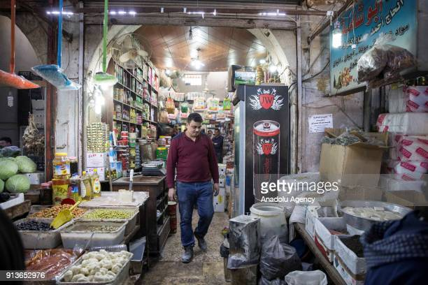 Syrian civilian is seen at his shop after PKK/PYD terror group fired seven missiles from Afrin region where Turkish Armed Forces conducts the...
