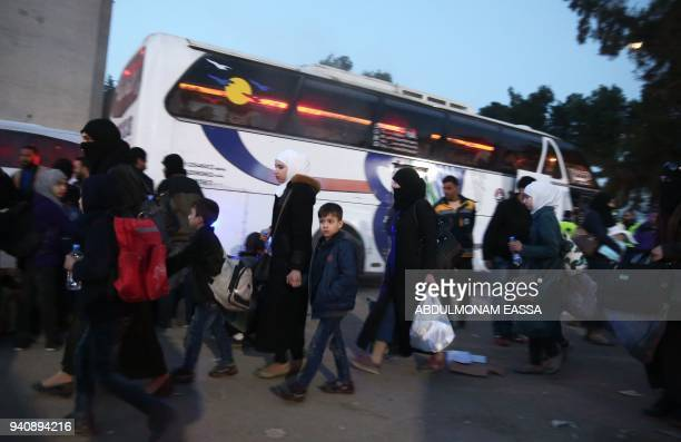 Syrian civilians and fighters arrive in Qalaat alMadiq some 45 kilometres northwest of the central city of Hama on April 2 2018 following their...