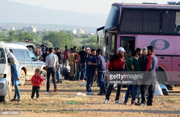 Syrian civilians and opponent forces members who were evacuated from AlWaer district of Homs arrive to Idlib's rural in Syria on May 22 2017