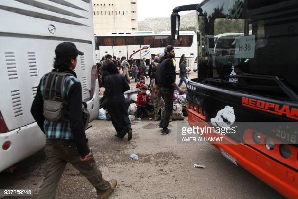 Syrian civilians and rebel fighters arrive in the village Mizanz some 30 kilometres northeast of Idlib on March 24 2018 after being evacuated from...