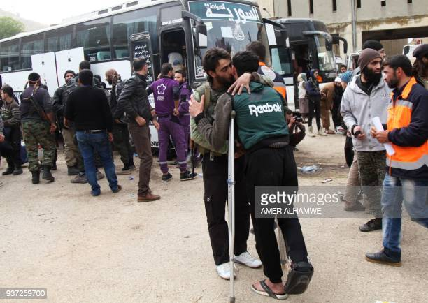 Syrian civilians and rebel fighters arrive in the village Mizanz some 30 kilometres northeast of Idlib on March 24 after being evacuated from Harasta...