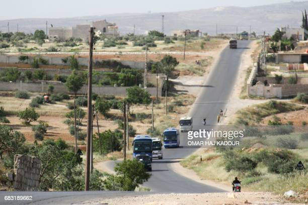Syrian civilians and rebels who were evacuated from the Qabun district in northeast Damascus arrive by bus at a temporary camp in the northern...