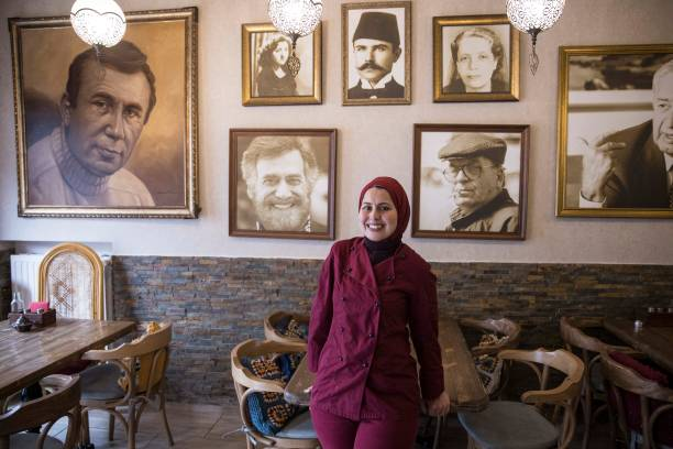 DEU: Syrian Refugees' Queen Of Cooking Chef Malakeh In Berlin