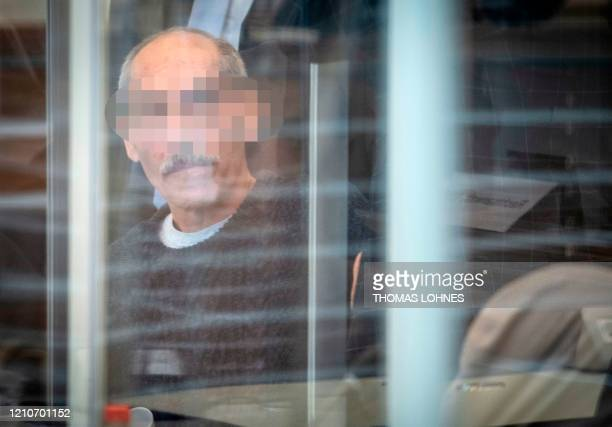 Syrian defendant Anwar Raslan arrives at court for an unprecedented trial on statesponsored torture in Syria on April 23 2020 at court in Koblenz...