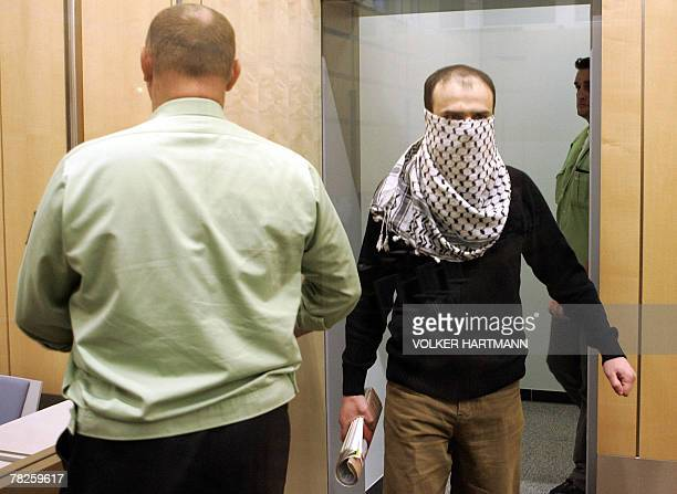 Syrian defendant Ibrahim Mohamed Khalil arrives for the start of his trial 05 December 2007 at court in Dusseldorf. The judges in the western city of...