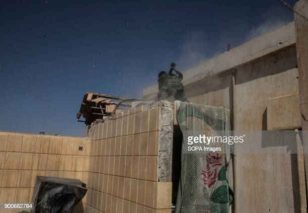 Syrian Democratic Force fighter firing a RPG toward the National Hospital a key position which was held by Islamic State jihadists along the Western...