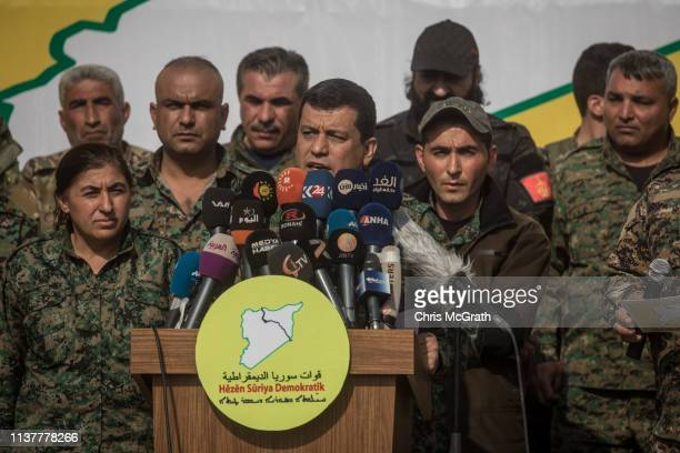 Syrian Democratic Force's commander in chief Mazloum Kobani speaks during a SDF victory ceremony announcing the defeat of ISIL in Baghouz held at...