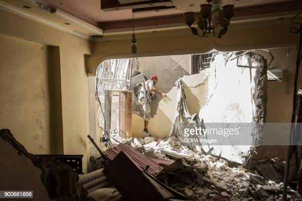 Syrian democratic forces fighter walks through rubbles in Raqqa SDF fighters are searching for Islamic State group jihadists in the ruined houses The...