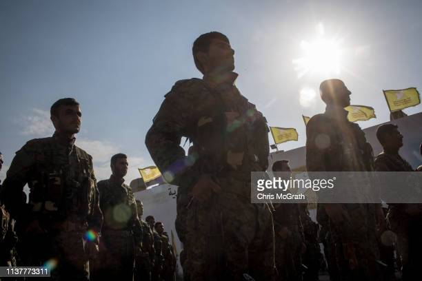 Syrian Democratic Forces fighters perform in a parade march during a SDF victory ceremony announcing the defeat of ISIL in Baghouz held at Omer Oil...