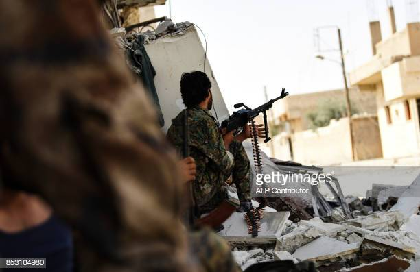 Syrian Democratic Forces hold a position on the eastern frontline of Raqa on September 24 as they battle with the support of US special forces to...