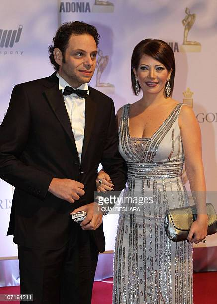 Syrian director Seif Sbei arrives with wife actress Sulafa Memar to attend the Adonia Awards party in Damascus late on November 26 2010 AFP...