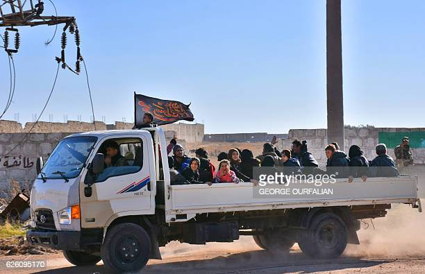 TOPSHOT Syrian displaced families arrive at a makeshift camp on November 27 2016 in the governmentheld district of Jibreen in Aleppo as civilians...