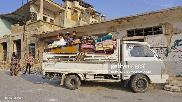 A Syrian displaced family who fled their hometown of Khan Sheikhun arrive with their belongings to the town of Binnish in the north Syrias...