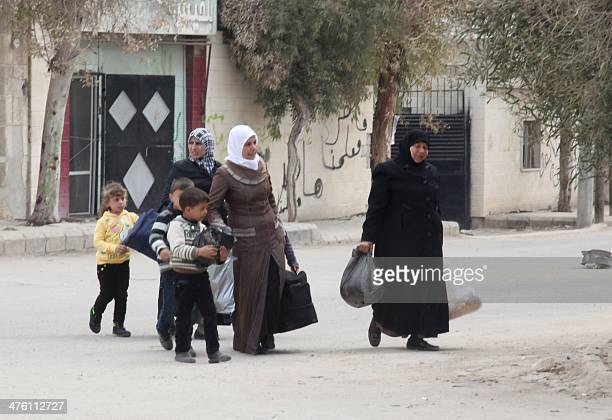 Syrian displaced residents of the besieged rebelheld town of Moadamiyet alSham in the suburbs of the capital Damascus return to their homes on March...