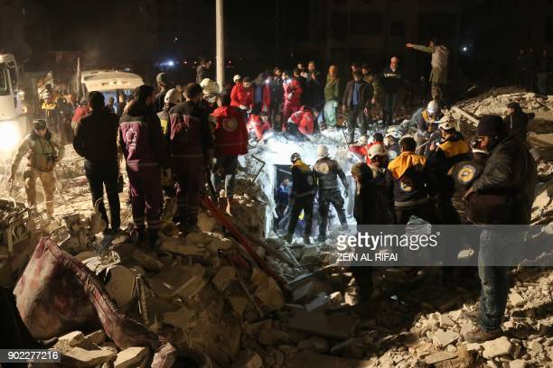 Syrian emergency personnel search for victims following an explosion at a base for Asian jihadists in a rebelheld area of the northwestern city of...