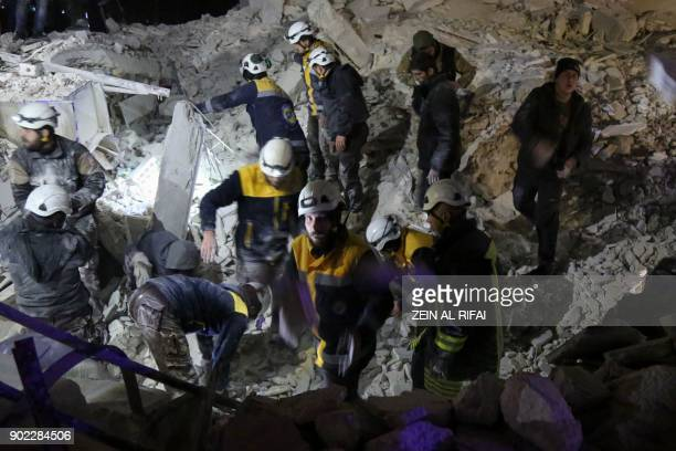 TOPSHOT Syrian emergency personnel search for victims following an explosion at a base for Asian jihadists in a rebelheld area of the northwestern...