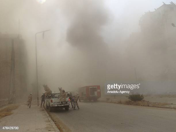 Syrian emergency staff arrive at a bakery after it was hit by a barrel bomb dropped by Syrian regime forces in Ansari neighborhood of Aleppo Syria on...
