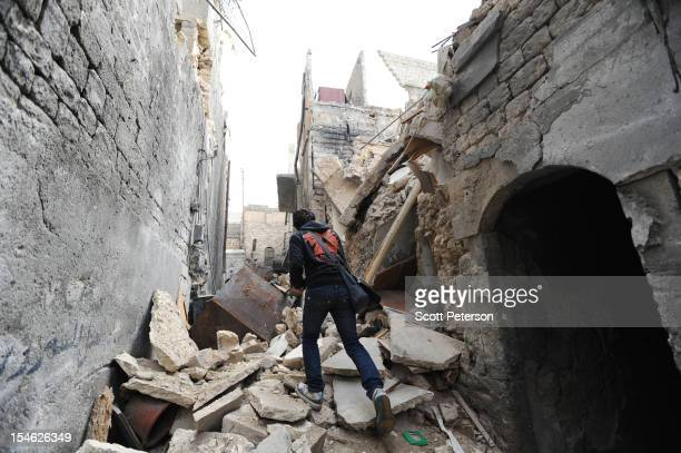Syrian examines the damage to old buildings from government air and artillery bombardment and a rising death toll after three months of intense...