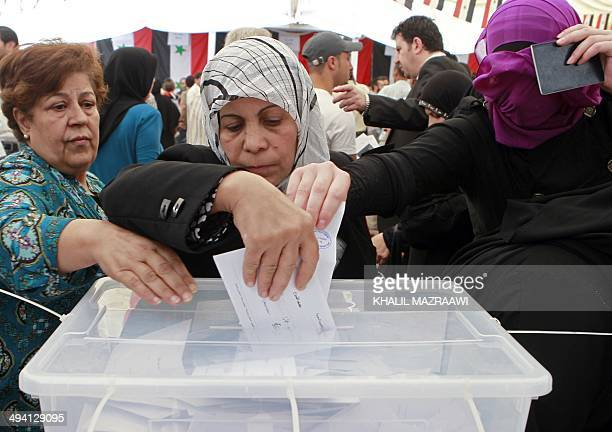 Syrian expatriates living in Jordan cast their ballots in their country's presidential elections at the Syrian embassy in Amman on May 28 2014 Polls...