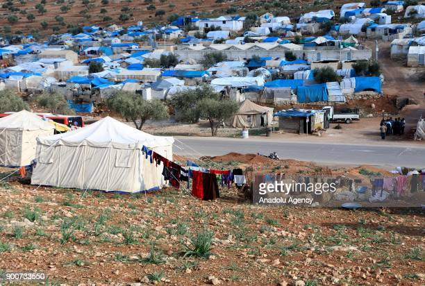 Syrian families are seen in Qah Village of Idlib Syria near refugee camps that host thousands of war victims fled from their homeland due to ongoing...