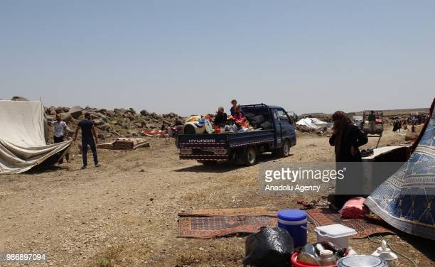 Syrian families are seen near the Golan Heights and the IsraelJordan border after they fled from the ongoing military operations by Bashar alAssad...