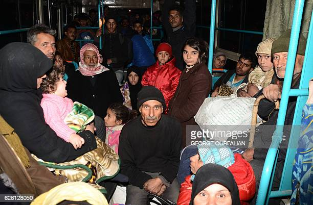 Syrian families from various eastern districts of Aleppo are evacuated by bus through Sheikh Maqsud a Kurdishcontrolled enclave between the...