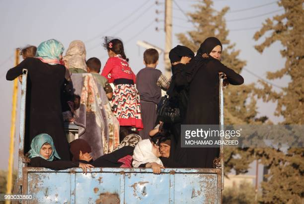 Syrian families return to their homes in towns and villages situated on the eastern outskirts of Daraa on July 6 2018 The Syrian regime reached a...
