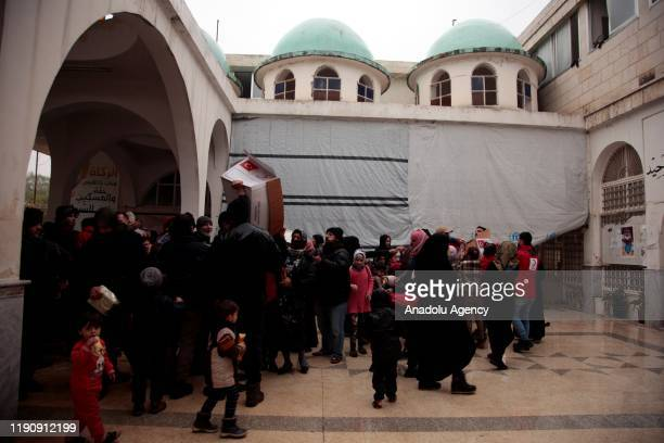 Syrian families take shelter in a mosque at city center due to bombardments in Idlib Syria on December 28 2019 The mosque about 40 kilometers from...