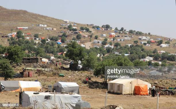 Syrian families' tents are seen near the Golan Heights and the IsraelJordan border after they fled from the ongoing military operations by Bashar...