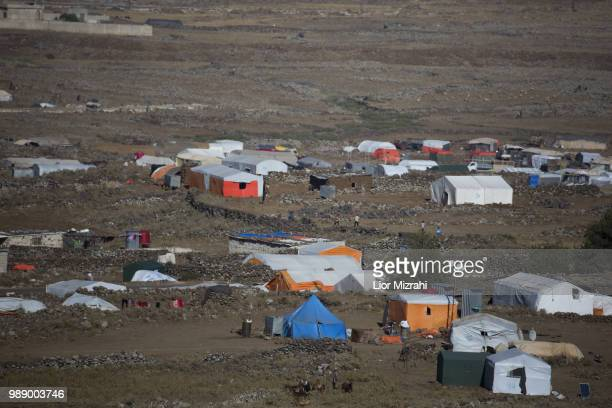 Syrian families' tents are seen near the Syrian village of Burayqah in the southern province of Daraa near the border with Syria on July 1 2018 in...