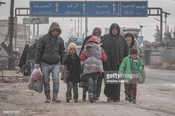 Syrian families, who have been forced to displace due to the ongoing attacks carried out by Assad regime and Russia, are seen on their way to safer...