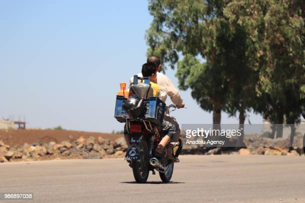 Syrian families who have been forced to flee due to the ongoing military operations by Bashar alAssad regime and its supporters are seen journeying...