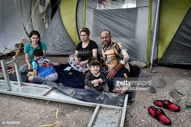 A Syrian family from Aleppo newly arrived to Greece sits in a makeshift camp on the island of Chios on October 13 2016 Some 270 refugee children are...