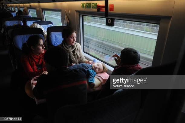 A Syrian family Hewa Mano Sherin Melak and their sleeping daughter Sipan are travelling in a train from Vienna via Passau to Germany 7 October 2015...