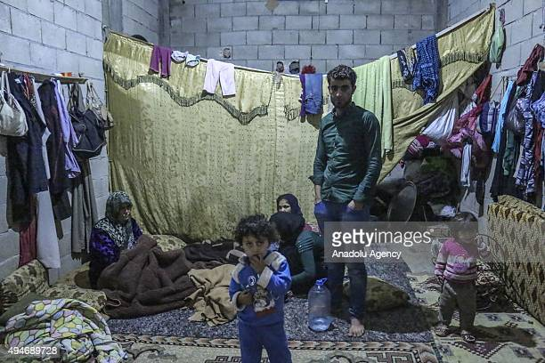Syrian family is seen inside their room in Reyhanli district of Hatay Province in southern Turkey on October 28 2015 Syrian families who fled the war...