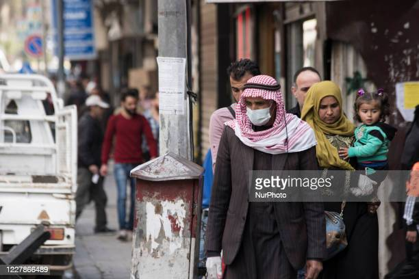 Syrian family preventative measure against Covid-19 at Damascus, Syria on July 30, 2020.