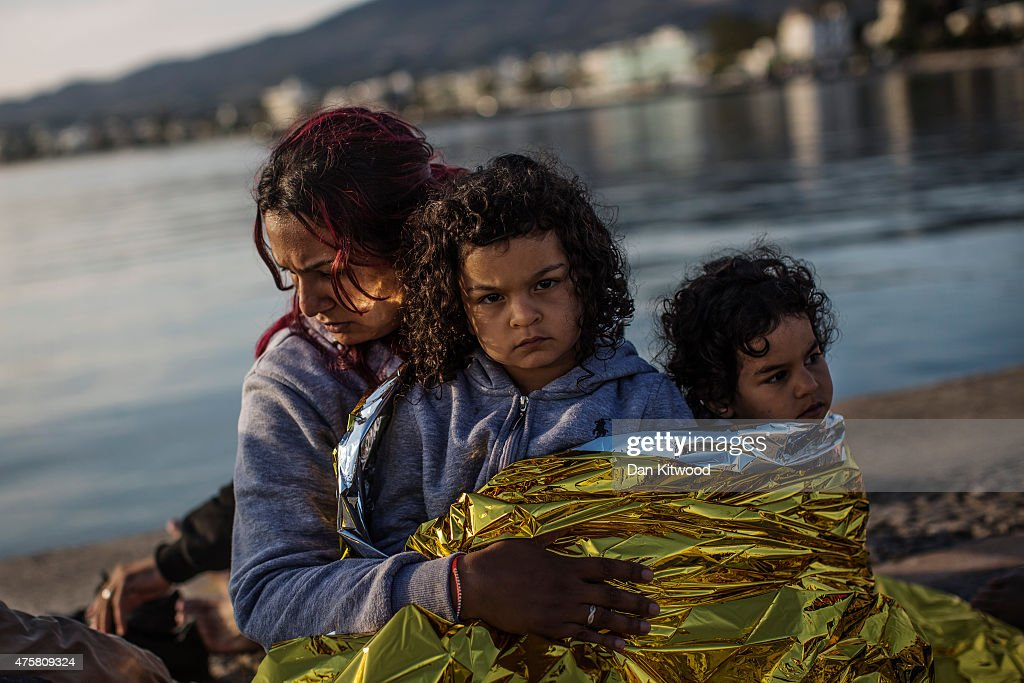 A Syrian family sit on the dock side after being escorted into the harbour by the Greek Coastguard who found them drifing offshore on June 04, 2015 in Kos, Greece. Many migrants are continuing to arrive on the Greek Island of Kos from Turkey. The Island has recently seen a drop in tourist numbers which has been attributed to negative reports on the migrant crisis that is continuing to grip the area. Many migrants are continuing to arrive on the Greek Island of Kos from Turkey. Around 30,000 migrants have entered Greece so far in 2015, with the country calling for more help from its European Union counterparts.