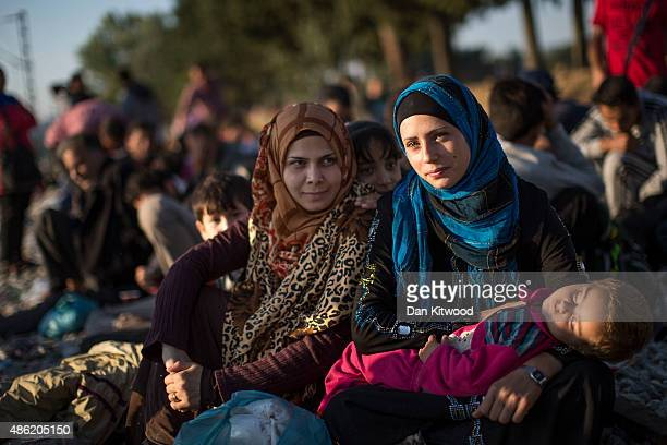 Syrian family waits along with hundreds of other families on train tracks at the Greek Macedonian border on September 2 2015 in Idomeni Greece...