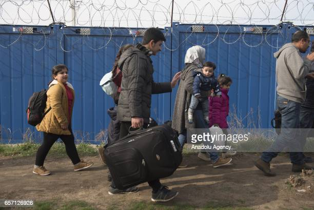 Syrian family waits next to the border gate after they were selected to claim asylum in Hungary at the Kelebija border crossing Subotica Serbia on...