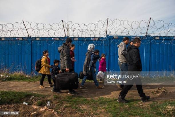 Syrian family walks towards the gate to cross to Hungary as they applied for asylum at the Kelebija border crossing point Hungary passed a Stop Soros...