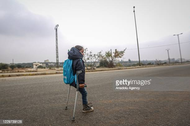 Syrian Fatima Ahmed al-Mustafa, who lost her left leg in an attack of Assad regime, walks with her crutches to her school in Idlib, Syria on November...
