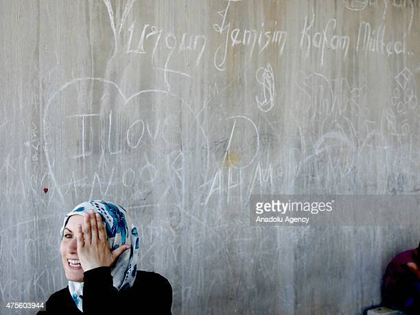 Syrian female refugee gestures under a bridge near a refugee camp site which is constructed by Turkish Prime Ministry's Disaster and Emergency...